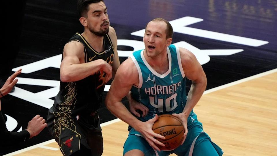Apr 22, 2021; Chicago, Illinois, USA; Charlotte Hornets center Cody Zeller (40) attempts to shoot against Chicago Bulls guard Tomas Satoransky (31) during the second quarter at the United Center. Mandatory Credit: Mike Dinovo-USA TODAY Sports