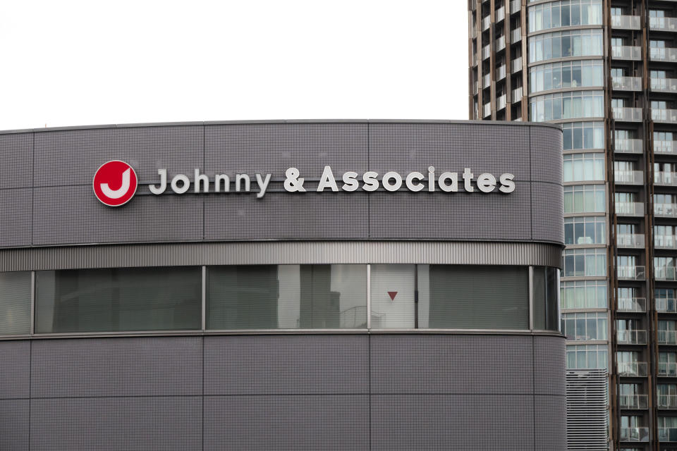 A sign hangs on the facade of the headquarters of Johnny & Associates talent agency founded by Johnny Kitagawa Wednesday, July 10, 2019, in Tokyo. Kitagawa, who produced famous boybands including Arashi and SMAP and was a kingpin of Japan's entertainment industry for more than half a century, has died Tuesday from a subarachnoid hemorrhage at a Tokyo hospital. He was 87. (AP Photo/Jae C. Hong)