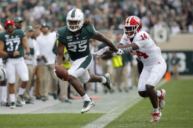 Michigan State receiver Darrell Stewart, left, is pushed out of bounds by Indiana's Andre Brown (14) after a pass reception during the first quarter of an NCAA college football game, Saturday, Sept. 28, 2019, in East Lansing, Mich. (AP Photo/Al Goldis)