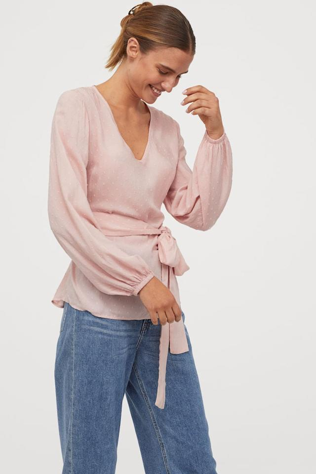 """<p>This <a href=""""https://www.popsugar.com/buy/HampM-Blouse-Tie-Belt-480671?p_name=H%26amp%3BM%20Blouse%20with%20Tie%20Belt&retailer=www2.hm.com&pid=480671&price=30&evar1=fab%3Aus&evar9=46520820&evar98=https%3A%2F%2Fwww.popsugar.com%2Fphoto-gallery%2F46520820%2Fimage%2F46520978%2FHM-Blouse-with-Tie-Belt&list1=shopping%2Cfall%20fashion%2Cfall%2Coffice%2Cworkwear%2Cunder%20%2450%2Caffordable%20shopping&prop13=api&pdata=1"""" rel=""""nofollow"""" data-shoppable-link=""""1"""" target=""""_blank"""" class=""""ga-track"""" data-ga-category=""""Related"""" data-ga-label=""""https://www2.hm.com/en_us/productpage.0763785001.html"""" data-ga-action=""""In-Line Links"""">H&amp;M Blouse with Tie Belt</a> ($30) also comes in white.</p>"""