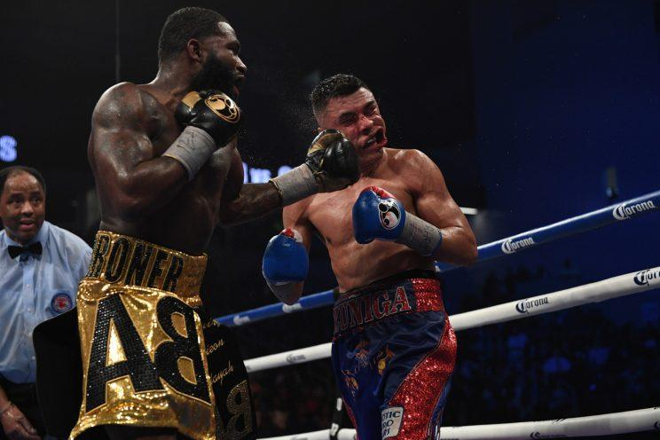 Adrien Broner lands against Adrian Granados in Broner's split decision win in February. (AP)