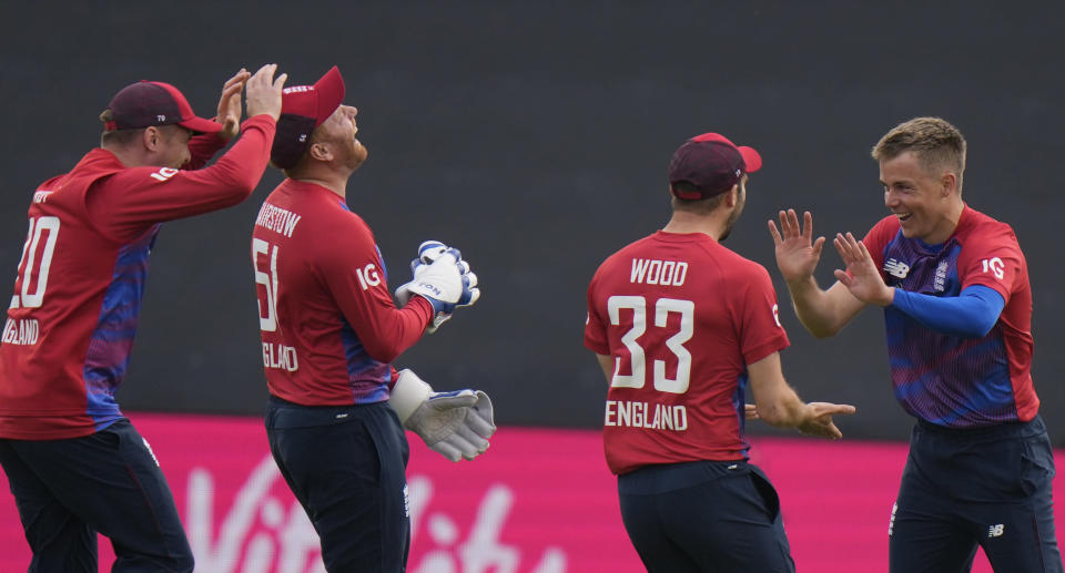 England's Sam Curran, (58) right, celebrates with teammates after running out Sri Lanka's Danushka Gunathilaka, during the second T20 international cricket match between England and Sri Lanka in Cardiff, Wales, Thursday, June 24, 2021. (AP Photo/Alastair Grant)