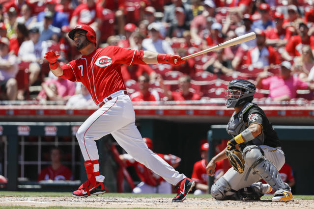 Cincinnati Reds' Eugenio Suarez watches his grand slam hit off Pittsburgh Pirates starting pitcher Ivan Nova in the third inning of a baseball game, Thursday, May 24, 2018, in Cincinnati. (AP Photo/John Minchillo)