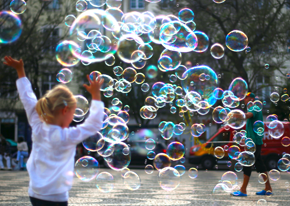 A street artist performs with soap bubbles at Rossio square in downtown Lisbon, Portugal April 28, 2017. REUTERS