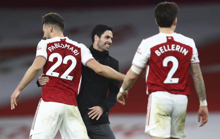 Arsenal's manager Mikel Arteta centre, congratulates his players after the end of the English Premier League soccer match between Arsenal and Chelsea at the Emirates stadium in London, Saturday, Dec. 26, 2020. Arsenal won the game 3-1. (Julian Finney Pool via AP)