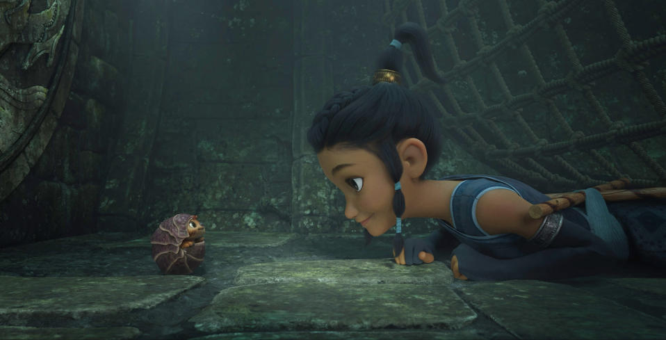 """Animated character Raya, voiced by Kelly Marie Tran, right, appears with Tuk Tuk, voiced by Alan Tudyk, in a scene from """"Raya and the Last Dragon."""" (Disney+ via AP)"""