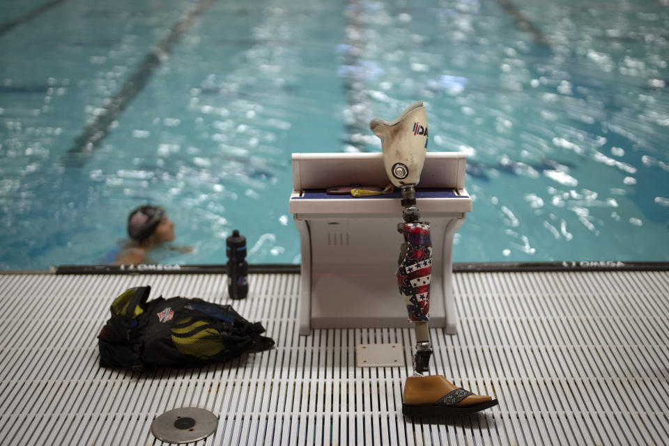 """Melissa Stockwell swims in a sports complex during her daily training in Colorado Springs, Colo., on Friday, Aug. 6, 2021. """"I'm not saying it's all unicorns and rainbows every day all day,"""" she says. But """"I accepted the loss of my leg early on, and that acceptance propelled me."""" (AP Photo/Emilio Morenatti)"""