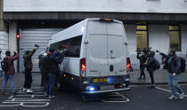 """Members of the media film and photograph the prison van with Julian Assange inside as it arrives at Westminster Magistrates Court for his Bail hearing in London, Wednesday, Jan. 6, 2021. On Monday Judge Vanessa Baraitser ruled that Julian Assange cannot be extradited to the US. because of concerns about his mental health. Assange had been charged under the US's 1917 Espionage Act for """"unlawfully obtaining and disclosing classified documents related to the national defence"""". Assange remains in custody, the US. has 14 days to appeal against the ruling. (AP Photo/Matt Dunham)"""