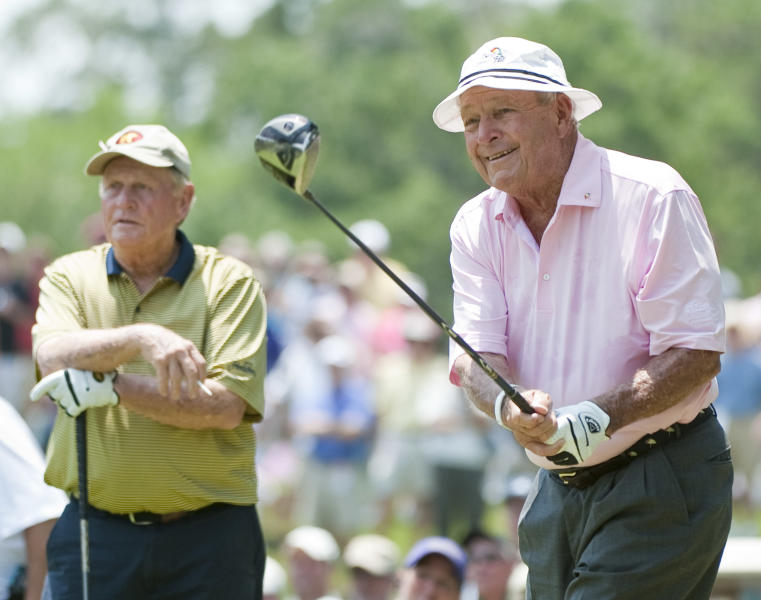 Arnold Palmer, right, and Jack Nicklaus, left, watch Palmer's tee shot on the second hole during the Greats of Golf event Saturday, May 5, 2012, in The Woodlands, Texas. (AP Photo/Dave Einsel)