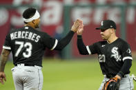 Chicago White Sox catcher Yermin Mercedes and second baseman Danny Mendick (20) celebrate after their baseball game against the Kansas City Royals Saturday, May 8, 2021, in Kansas City, Mo. The White Sox won 9-1. (AP Photo/Charlie Riedel)