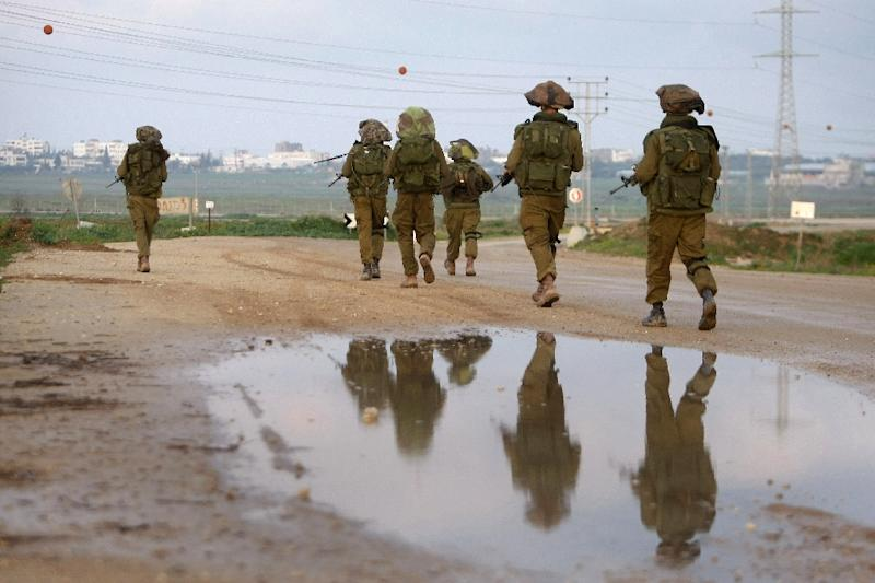 Israeli soldiers patrol the border with the Gaza Strip (AFP Photo/Menahem Kahana)