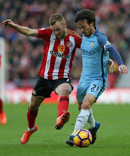 Manchester City's midfielder David Silva (R) vies with Sunderland's midfielder Sebastian Larsson during the English Premier League football match between Sunderland and Manchester City on March 5, 2017
