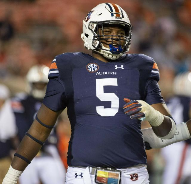 FILE - In this Sept. 29, 2018, file photo, Auburn defensive lineman Derrick Brown (5) warms up after a lightning delay in the first half of an NCAA college football game against Southern Mississippi, in Auburn, Ala. The SEC, a conference that prides itself on producing great defensive linemen and linebackers, must find candidates to replace all the guys heading into the pros. Alabamas Raekwon Davis and Auburns Derrick Brown both enter the summer as legitimate All-America candidates as they attempt to lead their teams.(AP Photo/Vasha Hunt, File)