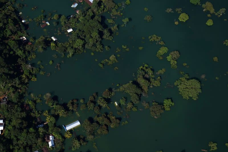 An aerial view shows rooftops of a village flooded by rains caused by Hurricanes Eta and Iota, in Alta Verapaz