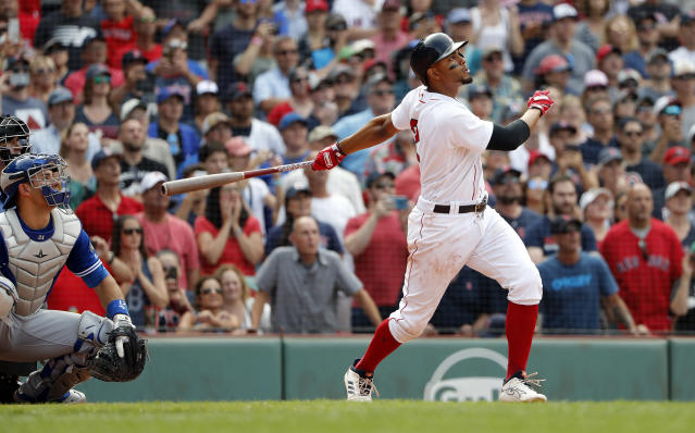 Boston Red Sox' Xander Bogaerts watches his grand slam along with Toronto Blue Jays catcher Luke Maile during the 10th inning of a baseball game Saturday, July 14, 2018, in Boston. The Red Sox won 6-2. (AP Photo/Winslow Townson)