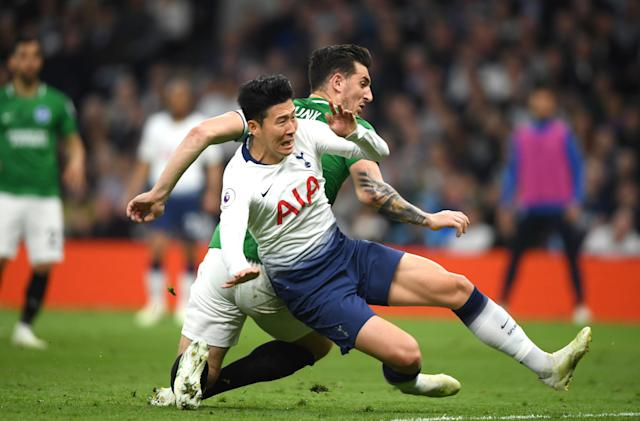 Heung-Min Son of Tottenham Hotspur is challenged by Lewis Dunk of Brighton and Hove Albion during the Premier League match between Tottenham Hotspur and Brighton & Hove Albion