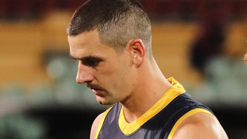 Taylor Walker is pictured walking off the field after an AFL game.