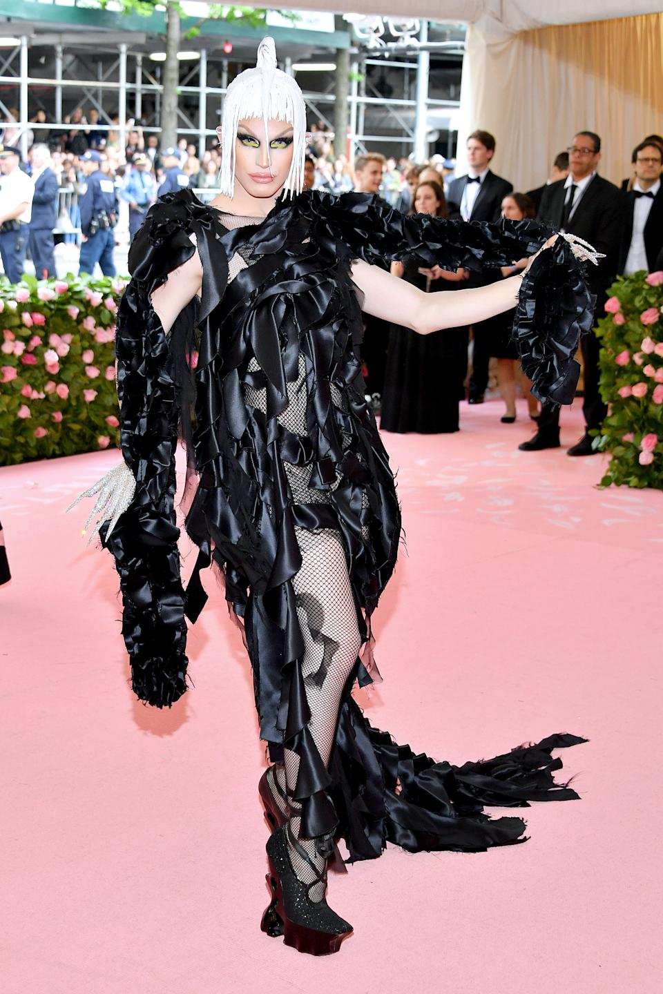Drag queen Aquaria was seen taking the Camp theme firmly in her stride, and arrived at the Met donning a black silk gown, ribboned by layers and matched to gem-encrusted, manicured gloves. Photo: Getty Images