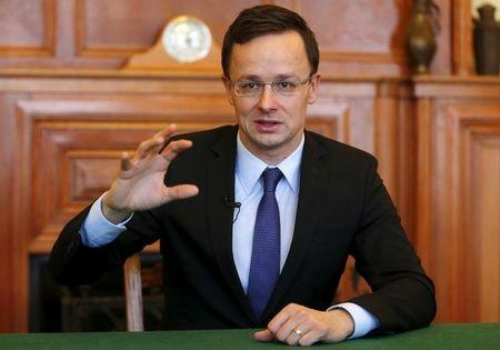 Hungarian Foreign Minister Peter Szijjarto gestures during an interview with Reuters in Budapest, Hungary
