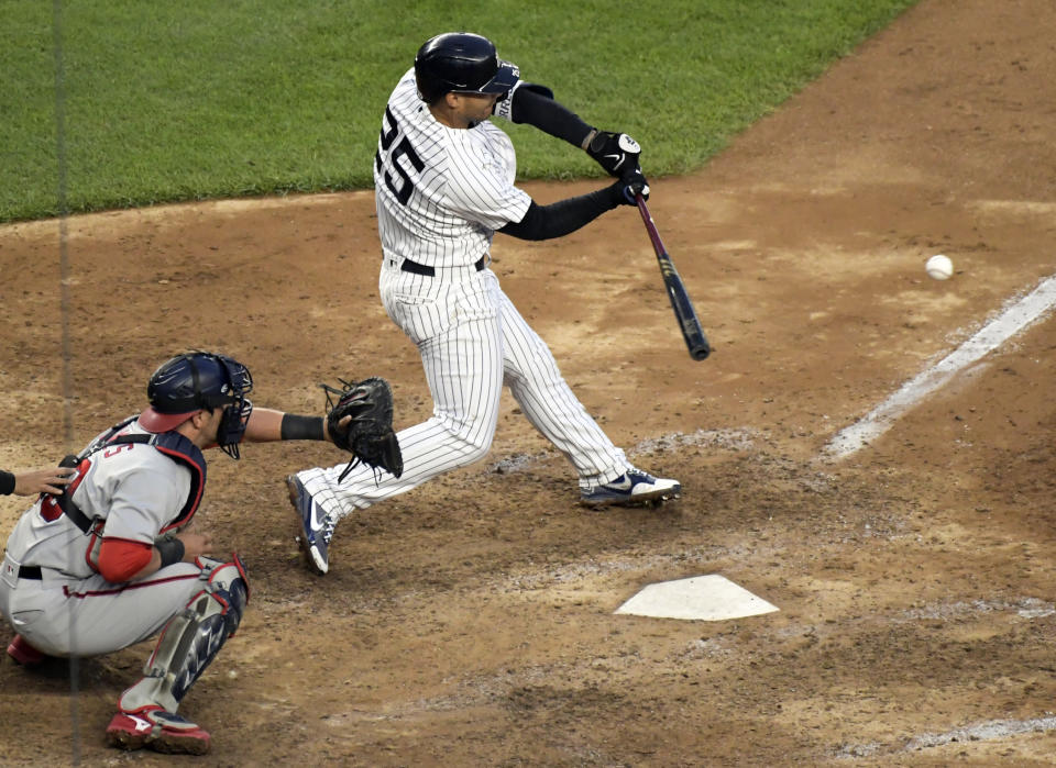 New York Yankees' Gleyber Torres (25) hits an infield RBI-single to score the winning run in the 11th inning of a baseball game against the Washington Nationals, Saturday, May 8, 2021, at Yankee Stadium in New York. The Yankees won 4-3. (AP Photo/Bill Kostroun)
