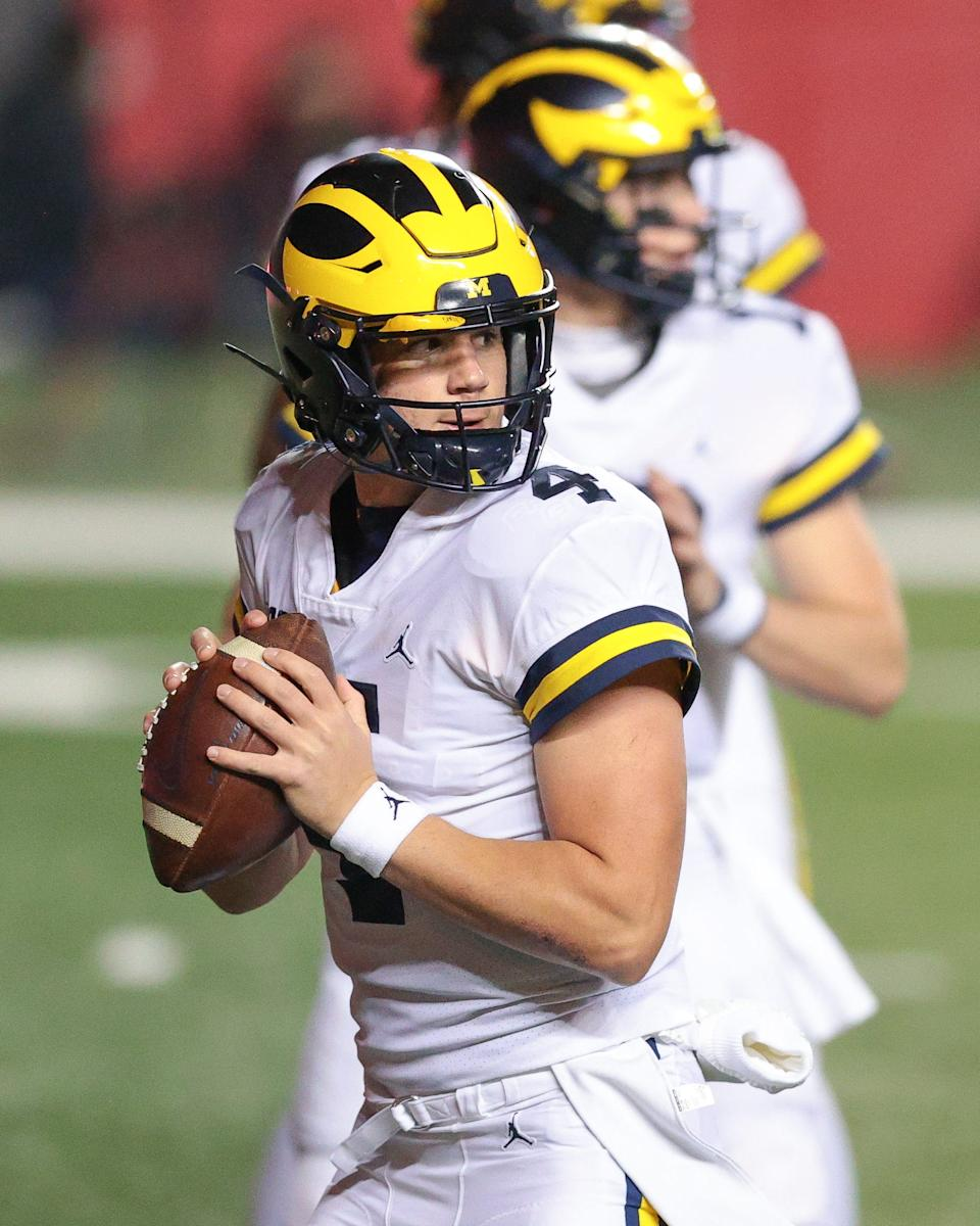 Michigan Wolverines backup quarterback Dan Villari (4) warms up before his game against the Rutgers Scarlet Knights at SHI Stadium on Saturday, Nov. 21, 2020.