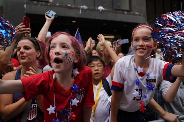 People wave the players of the U.S Women's National Soccer team during a Victory Parade and City Hall Ceremony in New York, United States on July 10, 2019. The U.S. won the 2019 FIFA Women's World Cup, beating the Netherlands 2-0 in the final on Sunday in the French city of Lyon. (Photo by Vural Elibol/Anadolu Agency/Getty Images)