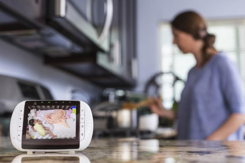 Mom in kitchen with baby monitor