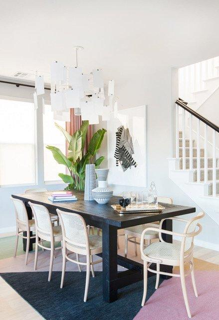 Wicker chairs, sleek tables, and carefully placed plants are sure to make your dining room stylish.