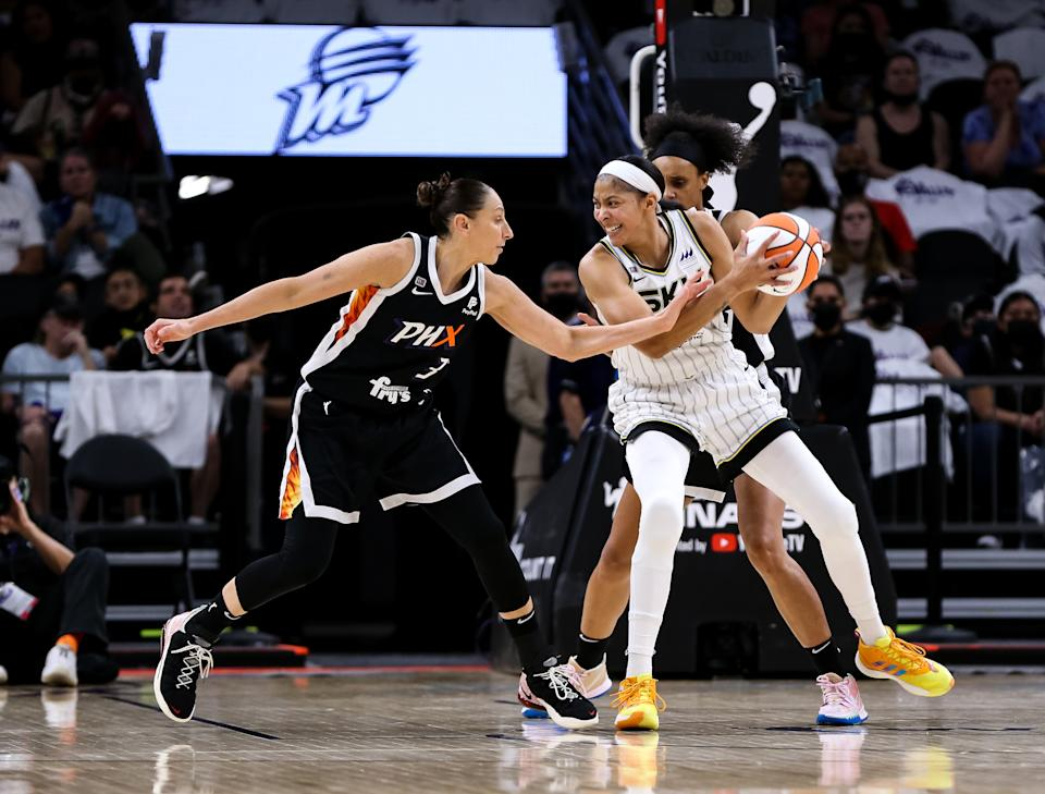 Diana Taurasi reaches in and fouls Candace Parker who is holding the basketball.