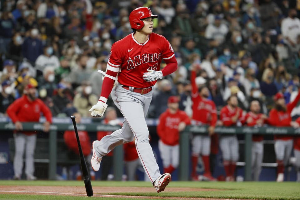 SEATTLE, WASHINGTON - OCTOBER 03: Shohei Ohtani #17 of the Los Angeles Angels watches his home run against the Seattle Mariners during the first inning at T-Mobile Park on October 03, 2021 in Seattle, Washington. (Photo by Steph Chambers/Getty Images)