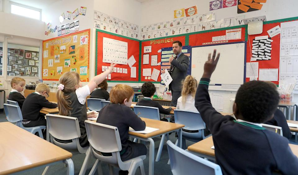 <p>A small increase in the school day could make a very, very big difference</p> (PA)