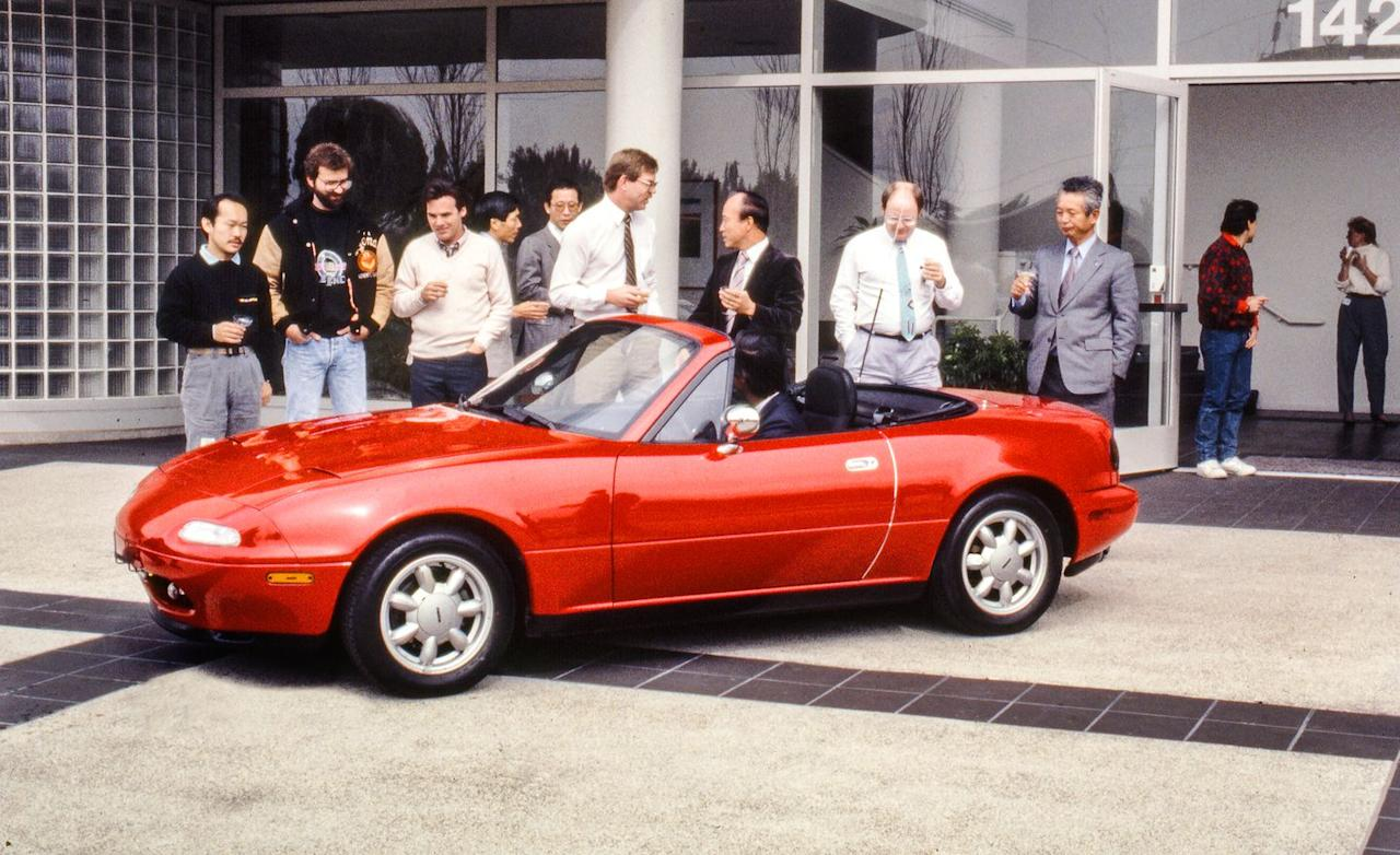 <p>After soliciting design proposals from its Japanese and American operations, Mazda picks the American option, which becomes the production MX-5 Miata. Unlike the Tokyo proposal, which was mid-engine, rear-drive like Toyota's contemporary MR2, and the front-drive sketch from Hiroshima, the product of Mazda's American design studio boasts a classic British sports-car layout: It is rear-drive, with its engine in front. </p>