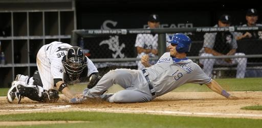 Chicago White Sox catcher Tyler Flowers, left, tags out Kansas City Royals' Danny Valencia at home on a throw from Alejandro De Aza, after Valencia tried to score from first on a double by Alcides Escobar, during the fourth inning of a baseball game Monday, July 21, 2014, in Chicago. (AP Photo/Charles Rex Arbogast)