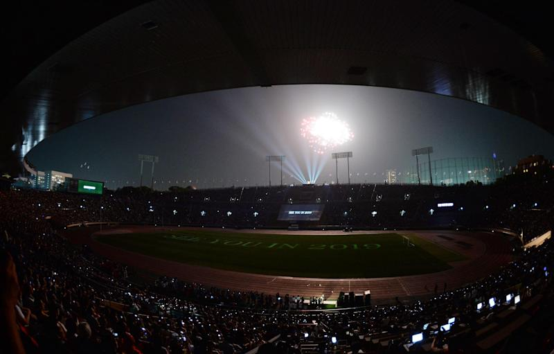 A fireworks display is seen over Japan's national stadium during the stadium's official farewell event in Tokyo on May 31, 2014