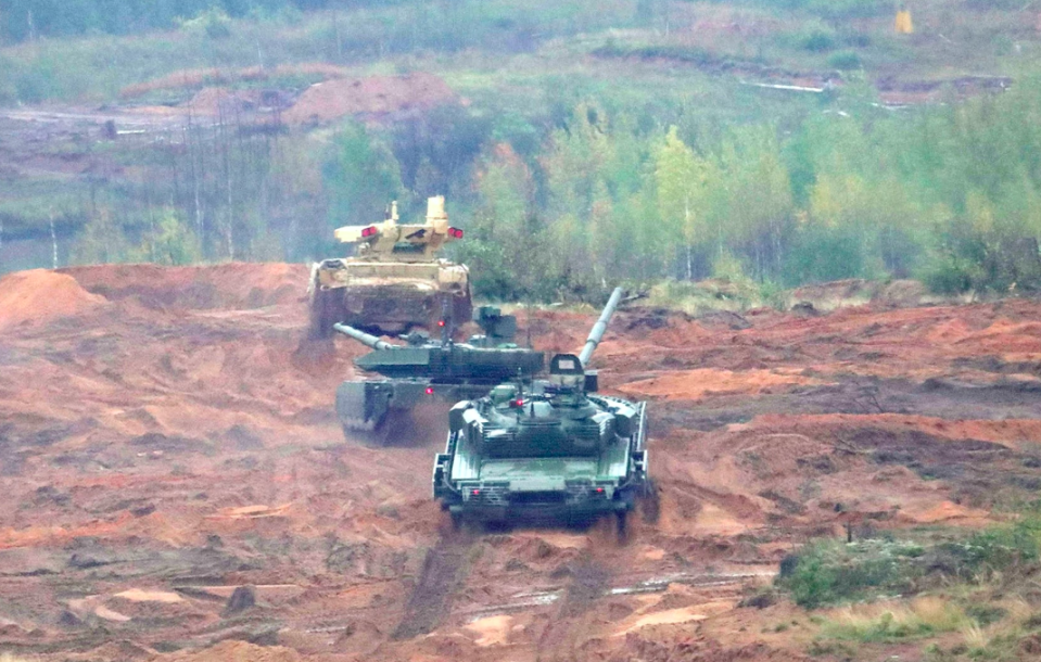 Russian tanks make manoeuvres during the Zapad West 2017 war games (Picture: Rex)