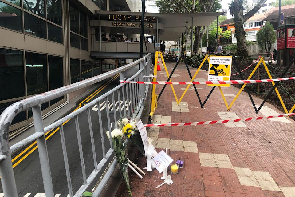 Flowers and cards seen at Lucky Plaza on Monday (30 December), a day after a fatal accident in which a car struck six Filipina domestic workers. (PHOTO: Dhany Osman / Yahoo News Singapore)