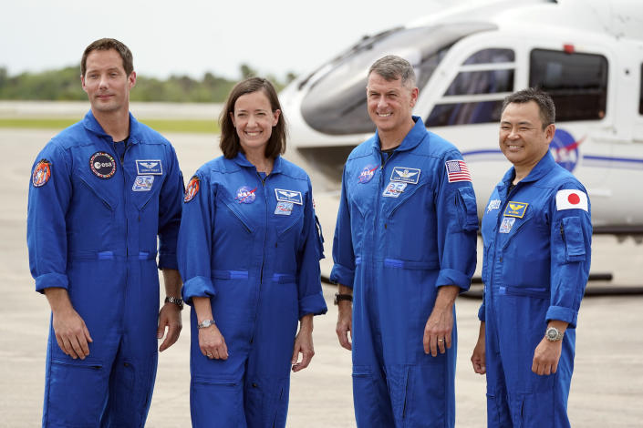 FILE - In this Friday, April 16, 2021 file photo, SpaceX Crew 2 members, from left, European Space Agency astronaut Thomas Pesquet, NASA astronauts Megan McArthur and Shane Kimbrough and Japan Aerospace Exploration Agency astronaut Akihiko Hoshide gather at the Kennedy Space Center in Cape Canaveral, Fla. This is the most internationally diverse crew yet for SpaceX. (AP Photo/John Raoux)