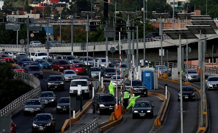 Mexico's finance ministry said the price of gasoline would rise by as much as 20.1 percent to $0.88 per liter on January 1, while diesel would rise 16.5 percent to $0.83 (AFP Photo/HECTOR GUERRERO)