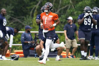 Chicago Bears quarterback Justin Fields runs on the field during NFL football practice in Lake Forest, Ill., Wednesday, July 28, 2021. (AP Photo/Nam Y. Huh)