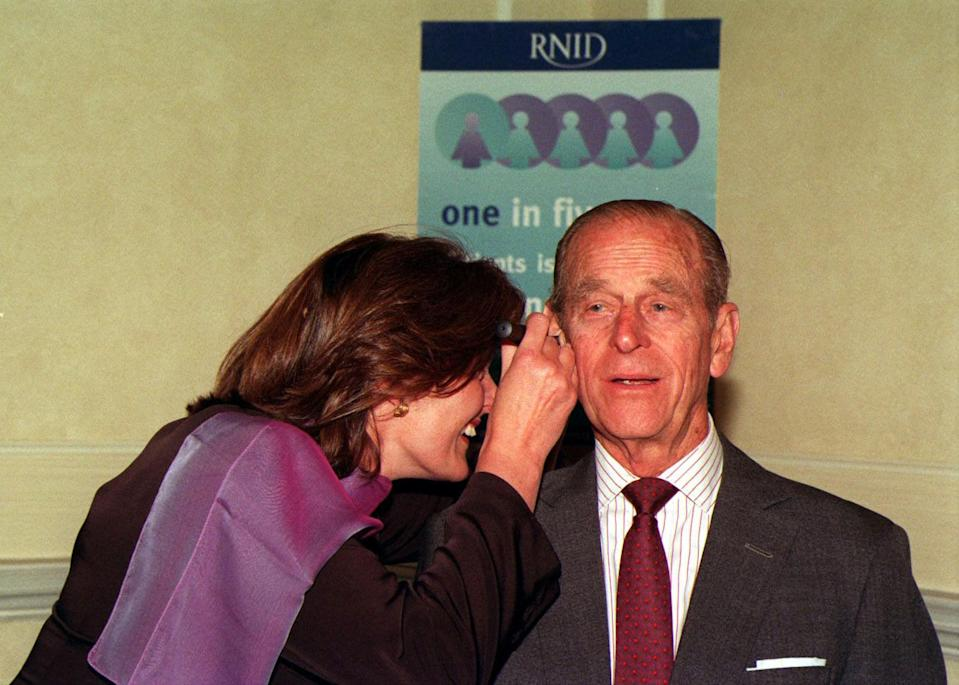 <p>The Duke of Edinburgh has his ears examined as he tries the facilities with a hearing test, during a visit to the Royal National Institute for Deaf People in London. The Duke, Patron of the Institute, was there to unveil a plaque to commemorate the founding of the organisation. (Photo credit: JOHN STILLWELL/PA Archive/PA Images) </p>