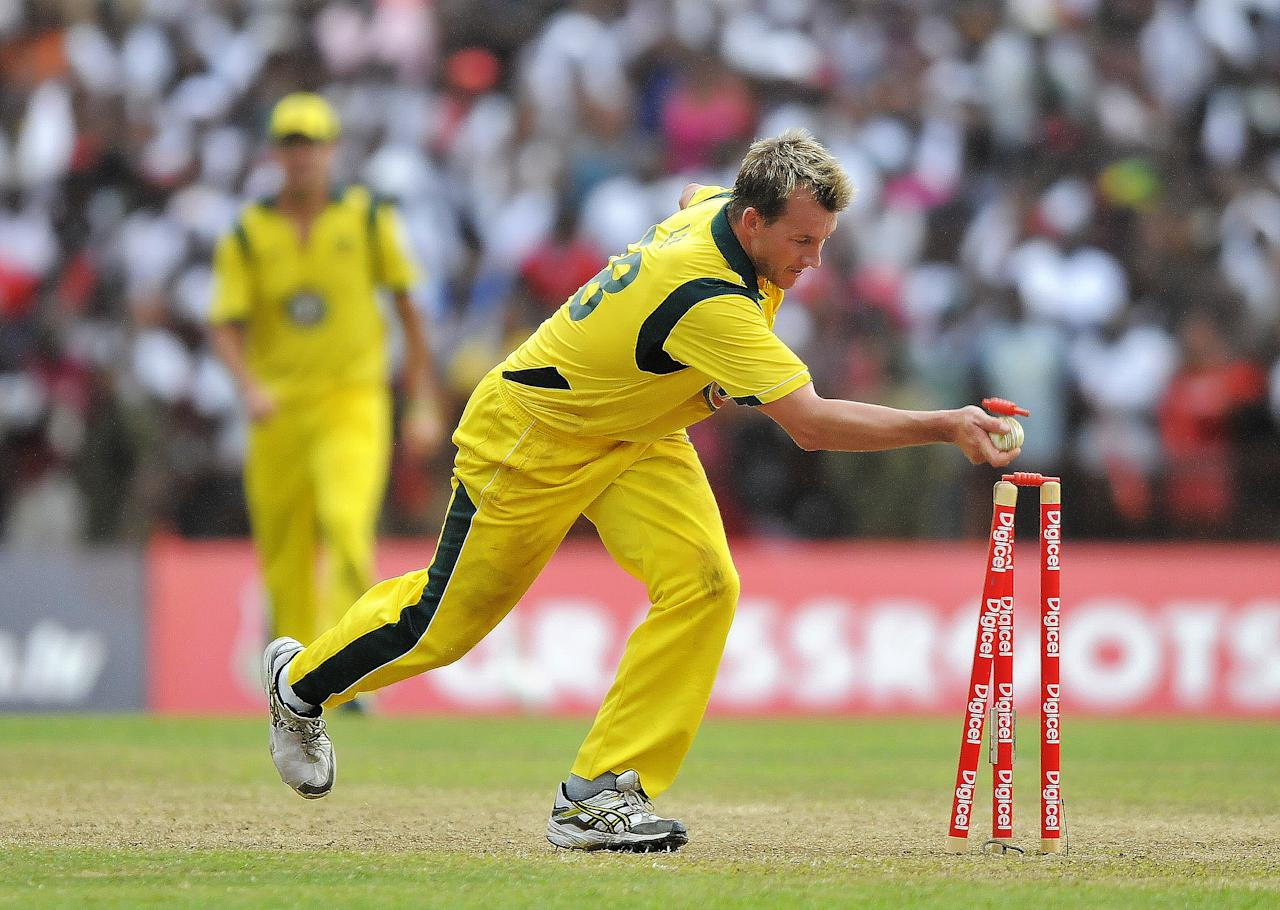 Australian cricketer Brett Lee runs out West Indies cricket team captain Darren Sammy during the third-of-five One Day International (ODI) matches between West Indies and Australia at the Arnos Vale Ground in Kingstown on March 20, 2012. The match was tied after the last over run-out. AFP PHOTO/Jewel Samad (Photo credit should read JEWEL SAMAD/AFP/Getty Images)