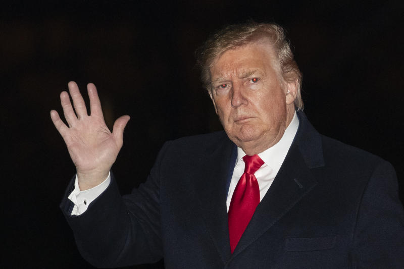 President Donald Trump waves upon his arrival back to the White House in Washington on Sunday, Jan. 19, 2020. (AP Photo/Manuel Balce Ceneta)