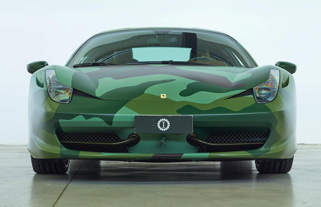 <p>Eccentric Fiat heir Lapo Elkann specced his 2010 Ferrari 458 Italia with the unusual army-style exterior. </p>