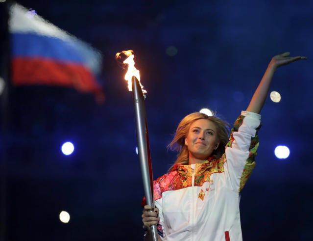 Russia's Maria Sharapova carries the torch during the opening ceremony of the 2014 Winter Olympics in Sochi, Russia, Friday, Feb. 7, 2014. (AP Photo/Matt Dunham)