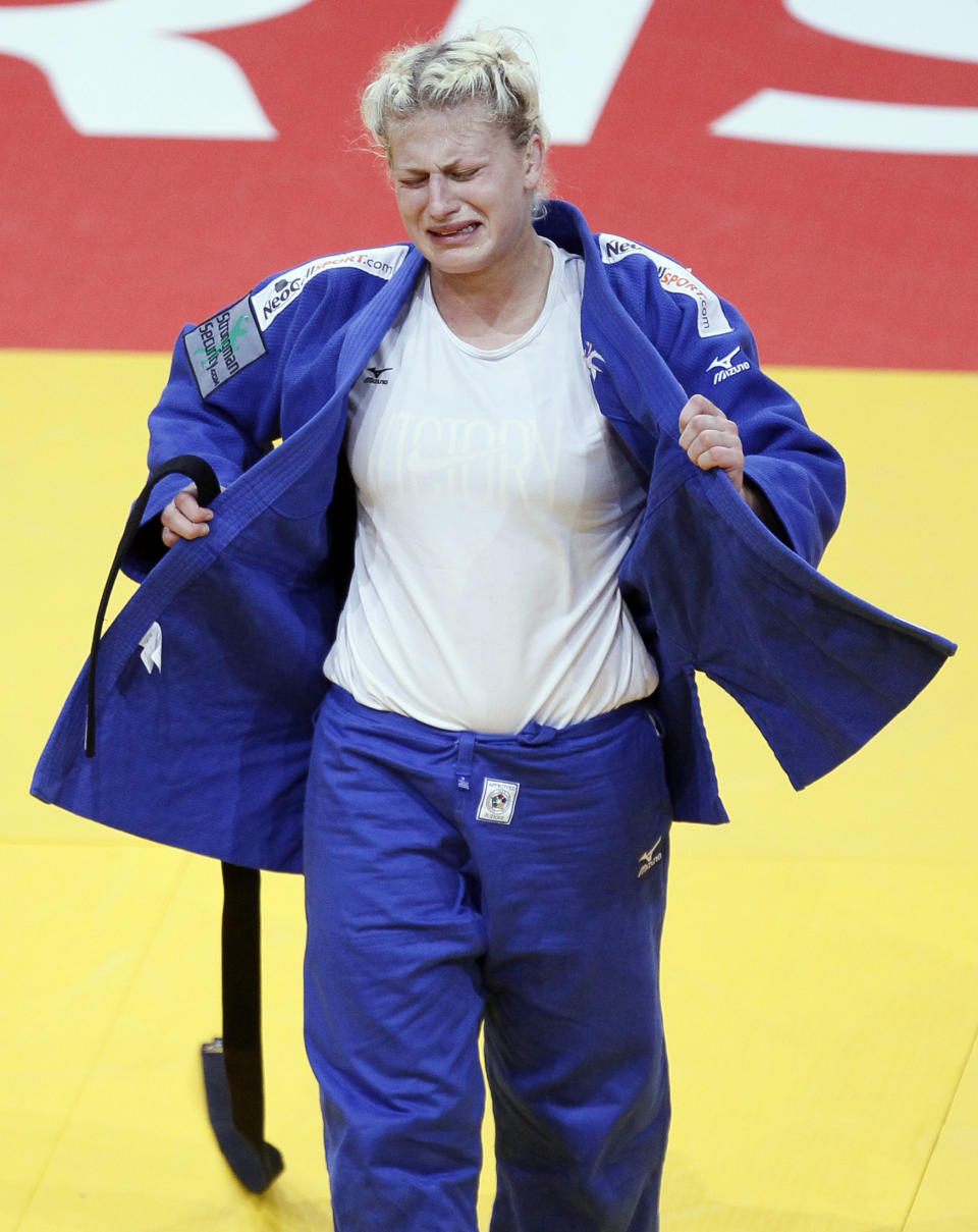 Kayla Harrison of the U.S. reacts after winning her under 78kg women's bronze medal bout against Marhinde Verkerk of the Netherlands at the World Judo Championships in Paris August 26, 2011. REUTERS/Yves Herman