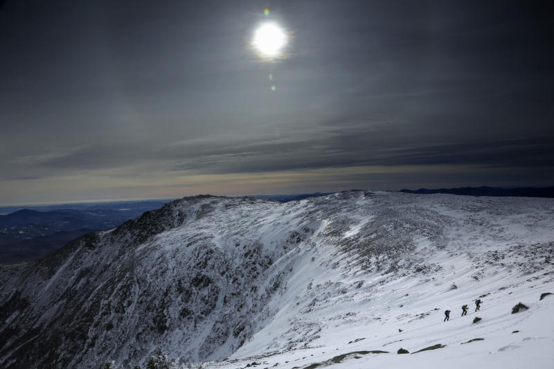 Under a midday winter solstice sun, a trio of climbers make their way up a slope on Mount Washington, Saturday, Dec. 21, 2019, in New Hampshire. Neither the sun nor the mercury rose very high as temperatures barely climbed out of the single digits on the shortest day of the year. The mountain had just 8 hours and 51 minutes of daylight on Saturday. (AP Photo/Robert F. Bukaty)