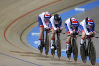 Team Britain competes during the first round of the women's team pursuit at the World Championships Track Cycling in Apeldoorn, eastern Netherlands, Netherlands, Thursday, March 1, 2018. (AP Photo/Peter Dejong)