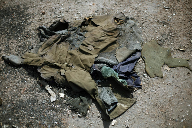 In this image taken during an official visit organized by the Malian army to the town of Konna, some 680 kilometers (430 miles) north of Mali's capital Bamako, Saturday, Jan. 26, 2013, a jacket lays on the ground of a destroyed base used by islamist rebels. One wing of Mali's Ansar Dine rebel group has split off to create its own movement, saying that they want to negotiate a solution to the crisis in Mali, in a declaration that indicates at least some of the members of the al-Qaida linked group are searching for a way out of the extremist movement in the wake of French air strikes. (AP Photo/Jerome Delay)