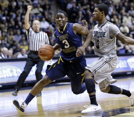 Purdue guard Ronnie Johnson, right, is called for a foul as he guards West Virginia guard Juwan Staten during the first half of an NCAA college basketball game in West Lafayette, Ind., Saturday, Jan. 19, 2013. (AP Photo/Michael Conroy)
