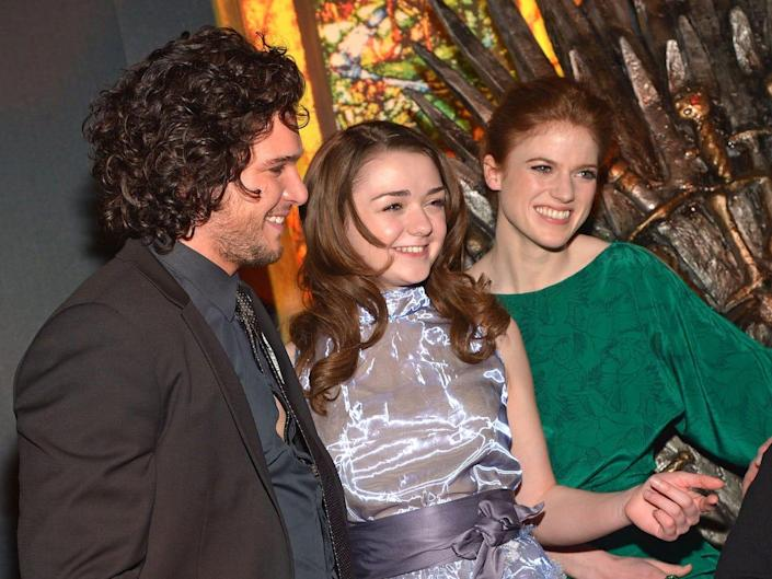 Kit Harington Rose Leslie and Maisie Williams at Game of Thrones exhibit march 2013 getty
